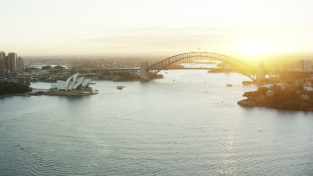 vídeos de stock, filmes e b-roll de aerial sunset sydney harbor bridge and opera house - sydney australia