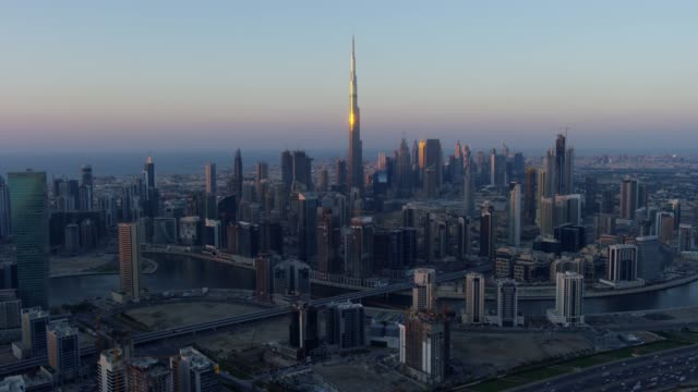 aerial sunset view burj khalifa dubai city skyscrapers - skyscraper stock videos & royalty-free footage
