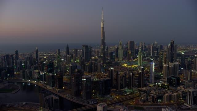 aerial sunset view burj khalifa dubai skyscrapers - burj khalifa stock videos & royalty-free footage