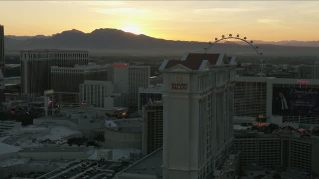 aerial sunset view caesars palace resort las vegas - casino stock videos & royalty-free footage