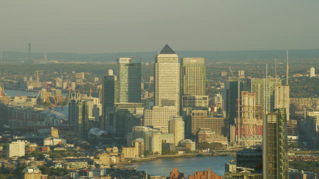 aerial sunset view canary wharf commercial skyscrapers london - canary wharf stock videos & royalty-free footage