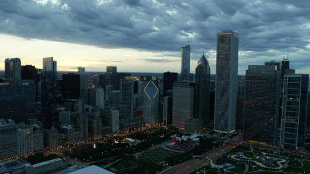 aerial sunset view chicago skyscrapers and millennium park - one prudential plaza stock videos & royalty-free footage