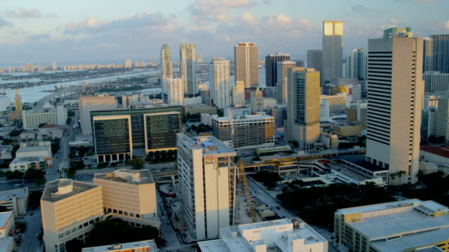 aerial sunset view downtown district city skyscrapers miami - biscayne bay stock videos & royalty-free footage