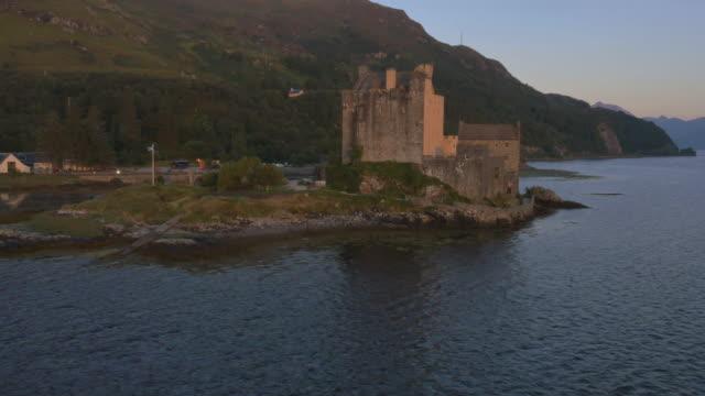 aerial sunset view eilean donan castle loch duich - loch duich stock videos & royalty-free footage