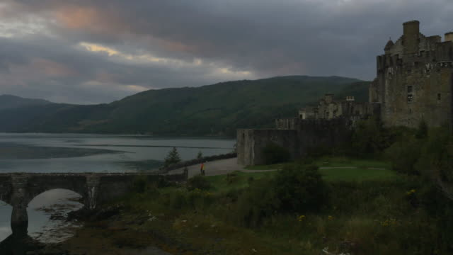 aerial sunset view eilean donan castle tourists scotland - scotland stock videos & royalty-free footage