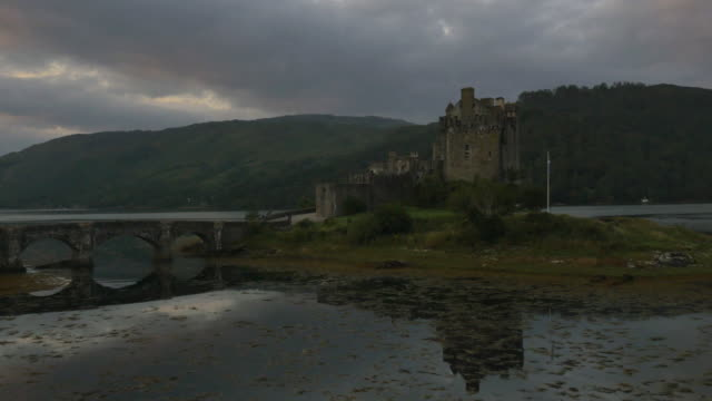 Aerial sunset view Eilean Donan castle tourists Scotland