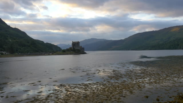 aerial sunset view eilean donan castle tourists scotland - dornie stock videos & royalty-free footage