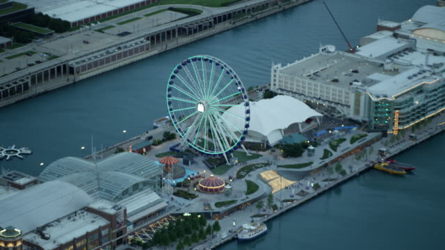 aerial sunset view ferris wheel chicago naval pier - ferris wheel stock videos & royalty-free footage
