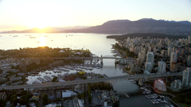aerial sunset view granville bridge vancouver city canada - vancouver canada stock videos & royalty-free footage