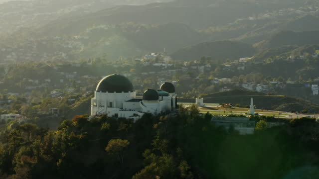 Aerial sunset view Griffith Observatory Hollywood Hills California