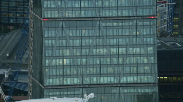 aerial sunset view leadenhall building illuminated offices london - crane stock videos & royalty-free footage