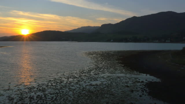 aerial sunset view loch duich mountain landscape scotland - dornie stock videos & royalty-free footage