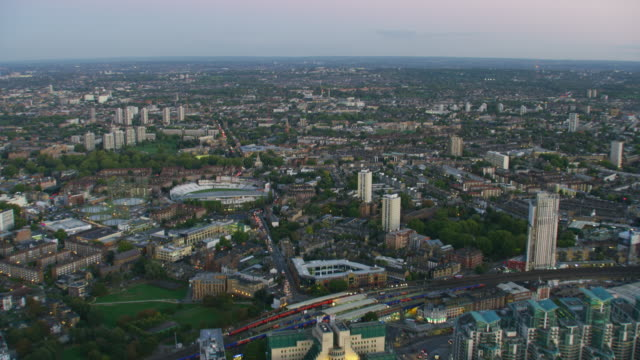 aerial sunset view london cityscape mi6 building england - aerial transport building stock videos & royalty-free footage
