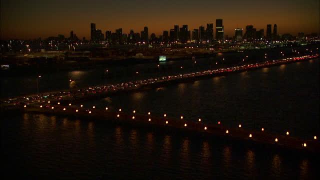 aerial sunset view macarthur vehicle causeway bridge miami - macarthur causeway bridge stock videos & royalty-free footage