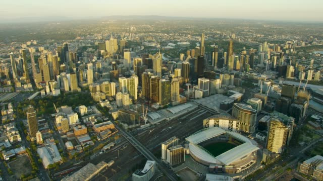 aerial sunset view melbourne cityscape with marvel stadium - global economy stock videos & royalty-free footage