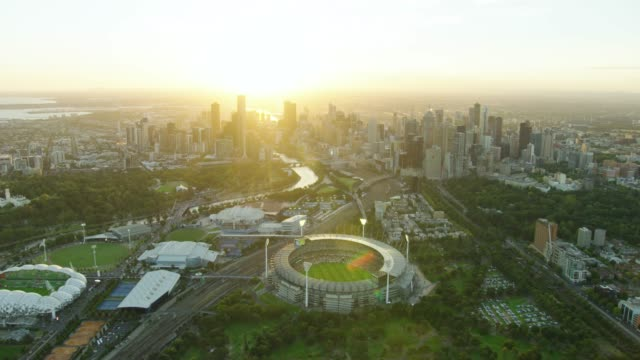 Aerial sunset view Melbourne Cricket Ground and cityscape