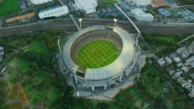 aerial sunset view melbourne cricket ground and railway - rail transportation stock videos & royalty-free footage
