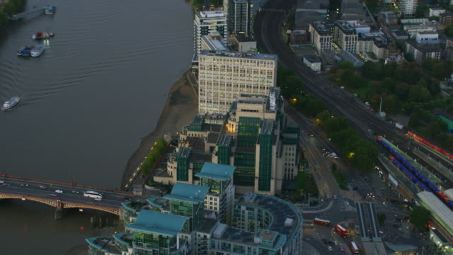 aerial sunset view mi6 building and london cityscape - mi6 stock-videos und b-roll-filmmaterial
