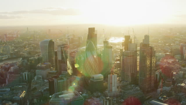 aerial sunset view modern glass commercial skyscrapers london - sir norman foster building stock videos & royalty-free footage