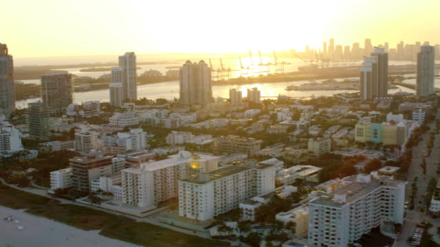aerial sunset view of art deco hotels miami - biscayne bay stock videos and b-roll footage
