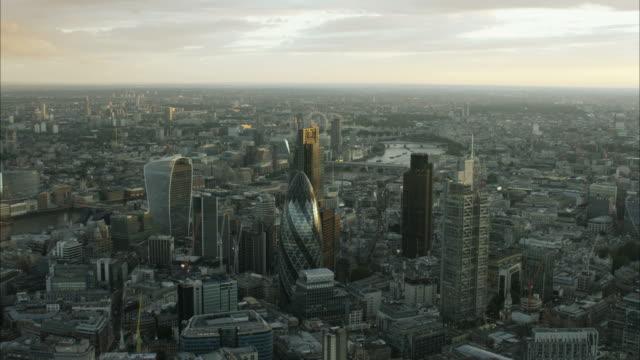 aerial sunset view of gherkin building london uk - shard london bridge stock videos & royalty-free footage