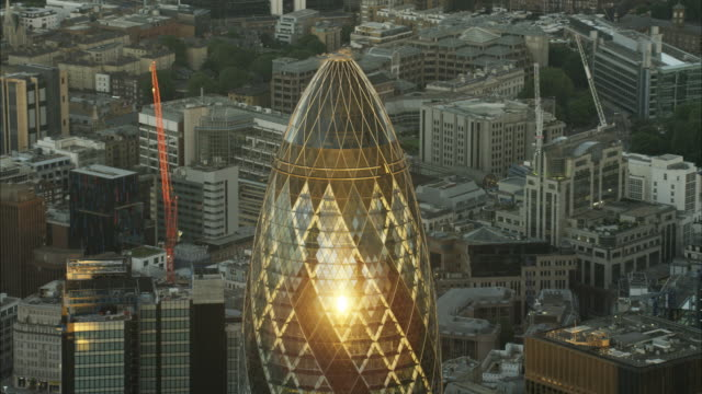 aerial sunset view of gherkin building london uk - cityscape stock videos & royalty-free footage