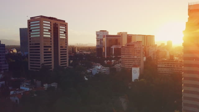 Aerial sunset view of Polanco skyline discovering the sun