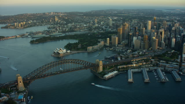 aerial sunset view of sydney harbor bridge - opera house stock videos & royalty-free footage
