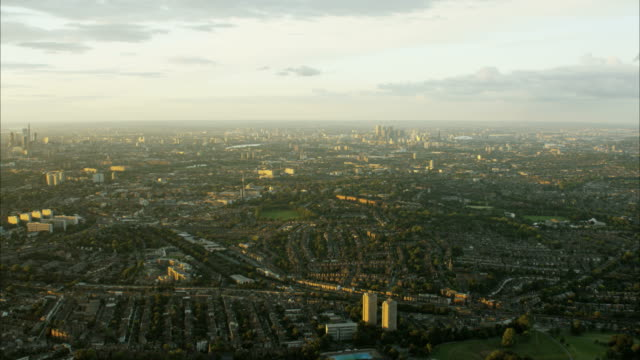 aerial sunset view of urban residential suburbs london - twilight stock videos & royalty-free footage