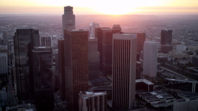 Aerial sunset view office skyscrapers downtown Los Angeles