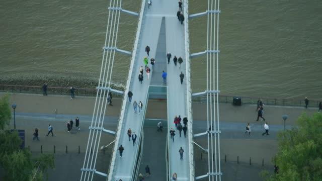 aerial sunset view pedestrians crossing river thames london - london millennium footbridge stock videos and b-roll footage