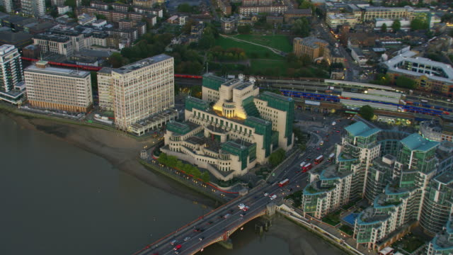 aerial sunset view sis mi6 building london england - twilight stock videos & royalty-free footage