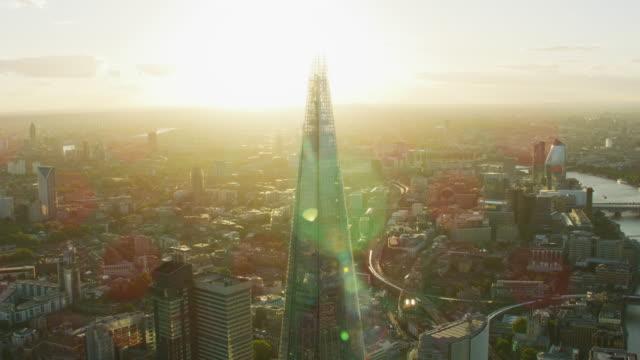 aerial sunset view the shard london sun flare - shard london bridge stock videos & royalty-free footage