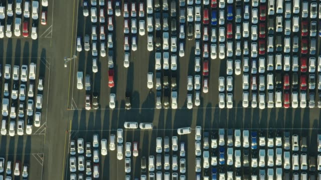 aerial sunset view vehicle logistics business port melbourne - car park stock videos & royalty-free footage