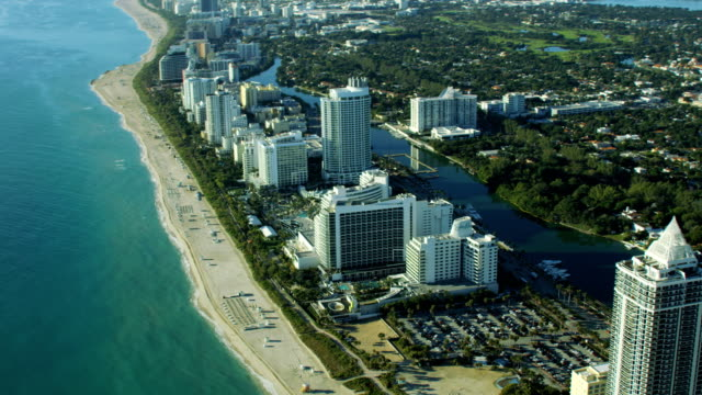 aerial sunset view waterfront fontainebleau hotel resort miami - biscayne bay stock videos & royalty-free footage