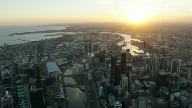 aerial sunset view yarra river through melbourne cbd - downtown stock videos & royalty-free footage