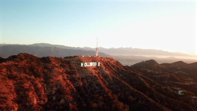 aerial: sunsets on hollywood sign - hollywood sign stock videos & royalty-free footage