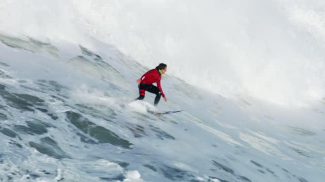 aerial surfer riding huge wave mavericks california america - northern california stock videos & royalty-free footage