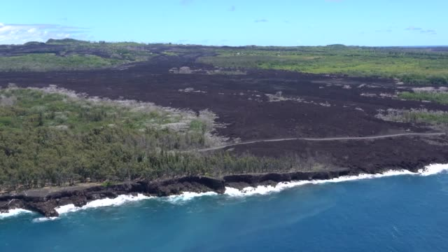 aerial survey footage of hawaii island a year after leilani estates volcano eruption - hawaii islands stock videos & royalty-free footage