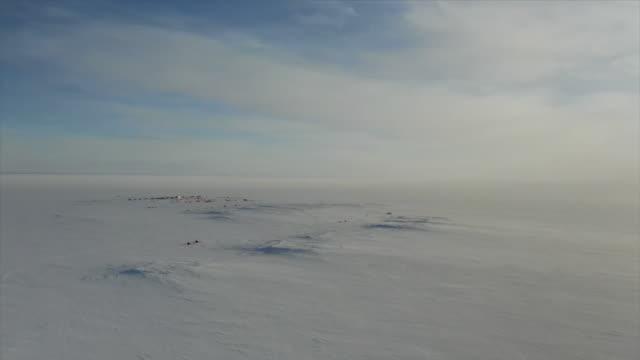 aerial survey tents on antarctic glacier - south pole stock videos & royalty-free footage