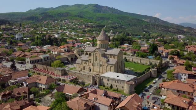 aerial /svetitskhoveli cathedral, a unesco world heritage site in mtskheta, georgia - tunic stock videos & royalty-free footage