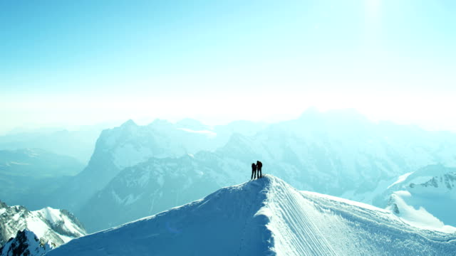 aerial swiss jungfrau mountain climbing alps mountaineering snow - oben stock-videos und b-roll-filmmaterial
