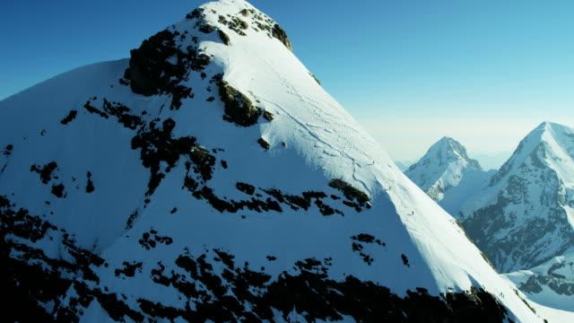 vidéos et rushes de aerial swiss jungfrau mountain summit climbers alps outdoor - alpes suisses