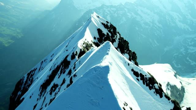 Aerial Swiss Jungfrau mountain summit climbers Alps snow