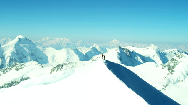 Aerial Swiss Jungfrau mountain summit climbers Alps
