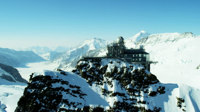 stockvideo's en b-roll-footage met aerial swiss jungfraujoch sphinx observatory mountain nature alps - skivakantie