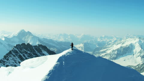 aerial swiss mountain alps mountaineering snow climbers outdoor - herausforderung stock-videos und b-roll-filmmaterial