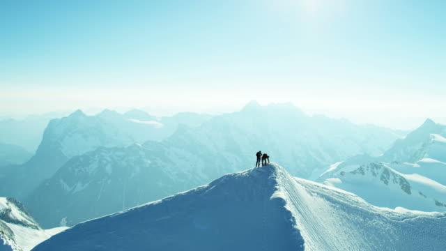 vidéos et rushes de aerial swiss mountain alps mountaineering snow climbers outdoor - alpes suisses