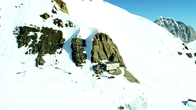 aerial switzerland jungfrau summit vacation tourism travel - rettung stock-videos und b-roll-filmmaterial