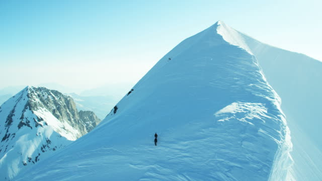 Aerial Switzerland Monch climbers mountain Alps snow travel